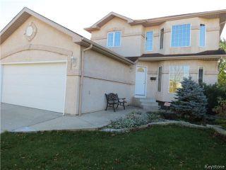 Photo 1: 115 Huntingdale Road in WINNIPEG: River Heights / Tuxedo / Linden Woods Residential for sale (South Winnipeg)  : MLS®# 1425559