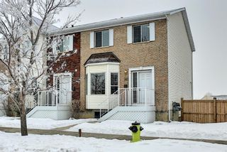 Photo 1: 185 Citadel Drive NW in Calgary: Citadel Row/Townhouse for sale : MLS®# A1066362