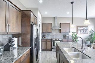Photo 10: 10 Auburn Sound Green SE in Calgary: Auburn Bay Detached for sale : MLS®# A1082880