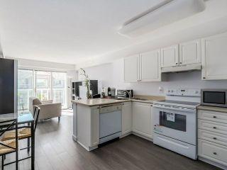 """Photo 2: 444 5880 DOVER Crescent in Richmond: Riverdale RI Condo for sale in """"WATERSIDE"""" : MLS®# R2237334"""