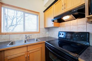 Photo 8: 101 72 Quigley Drive: Cochrane Apartment for sale : MLS®# A1091486