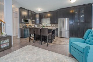 Photo 1: 57 1108 RIVERSIDE CLOSE in Port Coquitlam: Riverwood Townhouse for sale : MLS®# R2507739