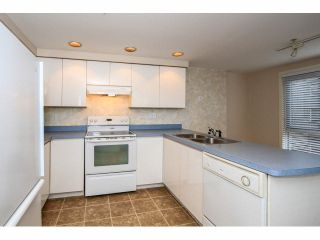 "Photo 9: 103 9978 148TH Street in Surrey: Guildford Condo for sale in ""HIGHPOINT GARDENS"" (North Surrey)  : MLS®# F1430440"