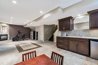 Photo 37: 157 Springbluff Boulevard SW in Calgary: Springbank Hill Detached for sale : MLS®# A1129724