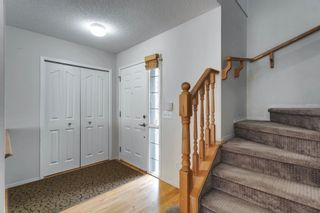 Photo 3: 7854 Springbank Way SW in Calgary: Springbank Hill Detached for sale : MLS®# A1142392