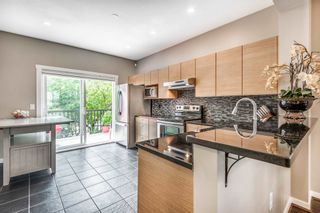 """Photo 4: 55 11067 BARNSTON VIEW Road in Pitt Meadows: South Meadows Townhouse for sale in """"COHO 1"""" : MLS®# R2603358"""