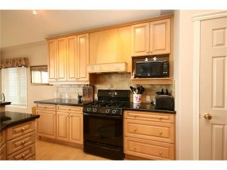 Photo 17: 313 GLENEAGLES View: Cochrane House for sale : MLS®# C4047766