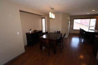 Photo 7: 151 Silverado Drive SW in Calgary: Silverado Detached for sale : MLS®# A1124527
