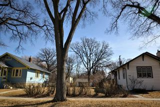 Photo 1: 318 Beaverbrook Street in Winnipeg: River Heights North Residential for sale (1C)  : MLS®# 202106213