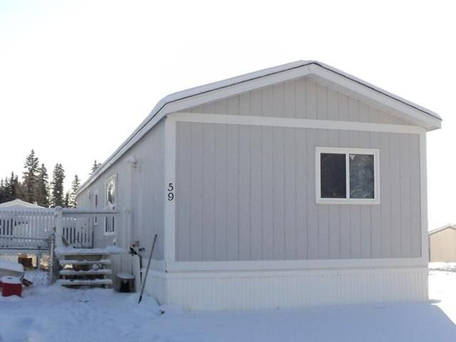 "Main Photo: 59 5701 AIRPORT Drive in Fort Nelson: Fort Nelson -Town Manufactured Home for sale in ""SOUTHRIDGE"" (Fort Nelson (Zone 64))  : MLS®# N214734"