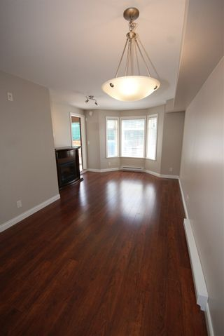 """Photo 7: 237 5660 201A Street in Langley: Langley City Condo for sale in """"Paddinton Station"""" : MLS®# R2188422"""