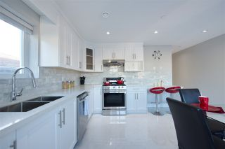 Photo 1: 5216 GLADSTONE STREET in Vancouver: Victoria VE 1/2 Duplex for sale (Vancouver East)  : MLS®# R2339569