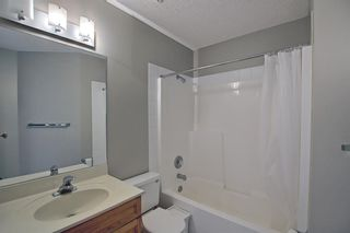 Photo 21: 106 Hamptons Link NW in Calgary: Hamptons Row/Townhouse for sale : MLS®# A1117431