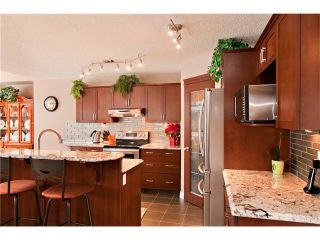 Photo 5: 48 COUGARSTONE Court SW in Calgary: Cougar Ridge House for sale : MLS®# C4045394