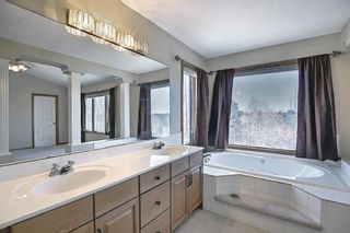Photo 21: 112 Mt Alberta View SE in Calgary: McKenzie Lake Detached for sale : MLS®# A1082178