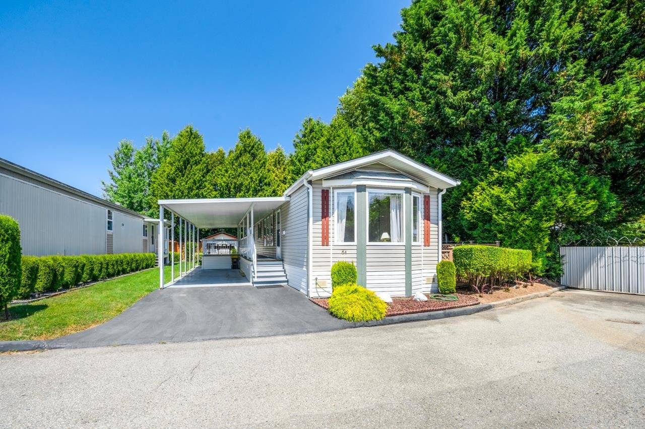 """Main Photo: 64 8254 134 Street in Surrey: Queen Mary Park Surrey Manufactured Home for sale in """"WESTWOOD ESTATES"""" : MLS®# R2597821"""