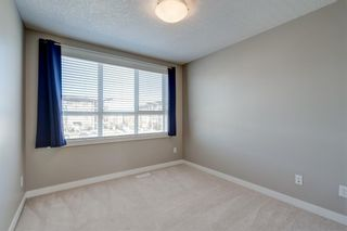 Photo 25: 103 Walgrove Cove SE in Calgary: Walden Row/Townhouse for sale : MLS®# A1145152