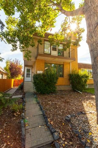 Photo 1: 11158 Sacramento Drive SW in Calgary: Southwood Semi Detached for sale : MLS®# A1081188