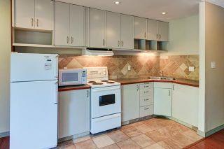Photo 2: 8 916 3 Avenue NW in Calgary: Sunnyside Condo for sale : MLS®# C3629661