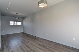 Photo 18: 158 23 Avenue NW in Calgary: Tuxedo Park Row/Townhouse for sale : MLS®# A1094441