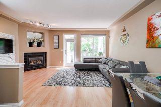"Photo 1: 38 7250 144 Street in Surrey: East Newton Townhouse for sale in ""Chimney Ridge"" : MLS®# R2584501"