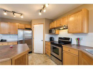 Photo 6: 1718 THORBURN Drive SE: Airdrie House for sale : MLS®# C4096360