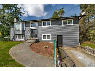 """Photo 3: 4011 206A Street in Langley: Brookswood Langley House for sale in """"Brookswood"""" : MLS®# R2564652"""