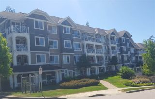 "Photo 1: 201 16388 64 Avenue in Surrey: Cloverdale BC Condo for sale in ""THE BOSE RIDGE FARMS"" (Cloverdale)  : MLS®# R2483722"
