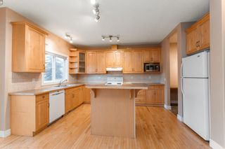 Photo 6: 7 39 Strathlea Common SW in Calgary: Strathcona Park Semi Detached for sale : MLS®# A1056254