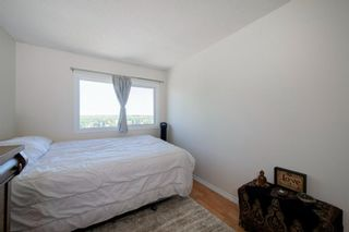 Photo 32: 332 Queenston Heights SE in Calgary: Queensland Row/Townhouse for sale : MLS®# A1114442