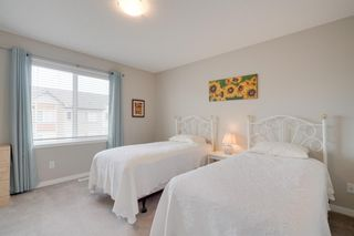 Photo 23: 133 Copperpond Villas SE in Calgary: Copperfield Row/Townhouse for sale : MLS®# A1061409