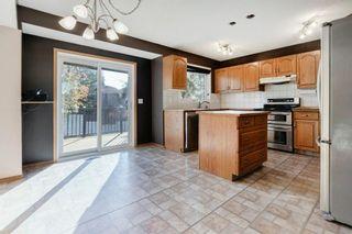 Photo 9: 142 Hawkdale Circle NW in Calgary: Hawkwood Detached for sale : MLS®# A1150961