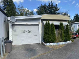 """Photo 1: 33 4200 DEWDNEY TRUNK Road in Coquitlam: Ranch Park Manufactured Home for sale in """"HIDEAWAY PARK"""" : MLS®# R2490732"""