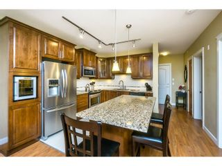 """Photo 2: 527 8288 207A Street in Langley: Willoughby Heights Condo for sale in """"Yorkson Creek Walnut Ridge II"""" : MLS®# R2051394"""