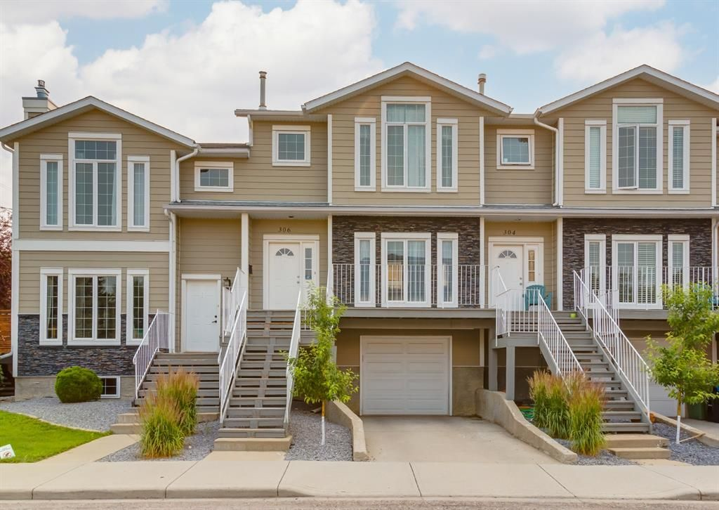 Main Photo: 306 20 Street NW in Calgary: West Hillhurst Row/Townhouse for sale : MLS®# A1130619
