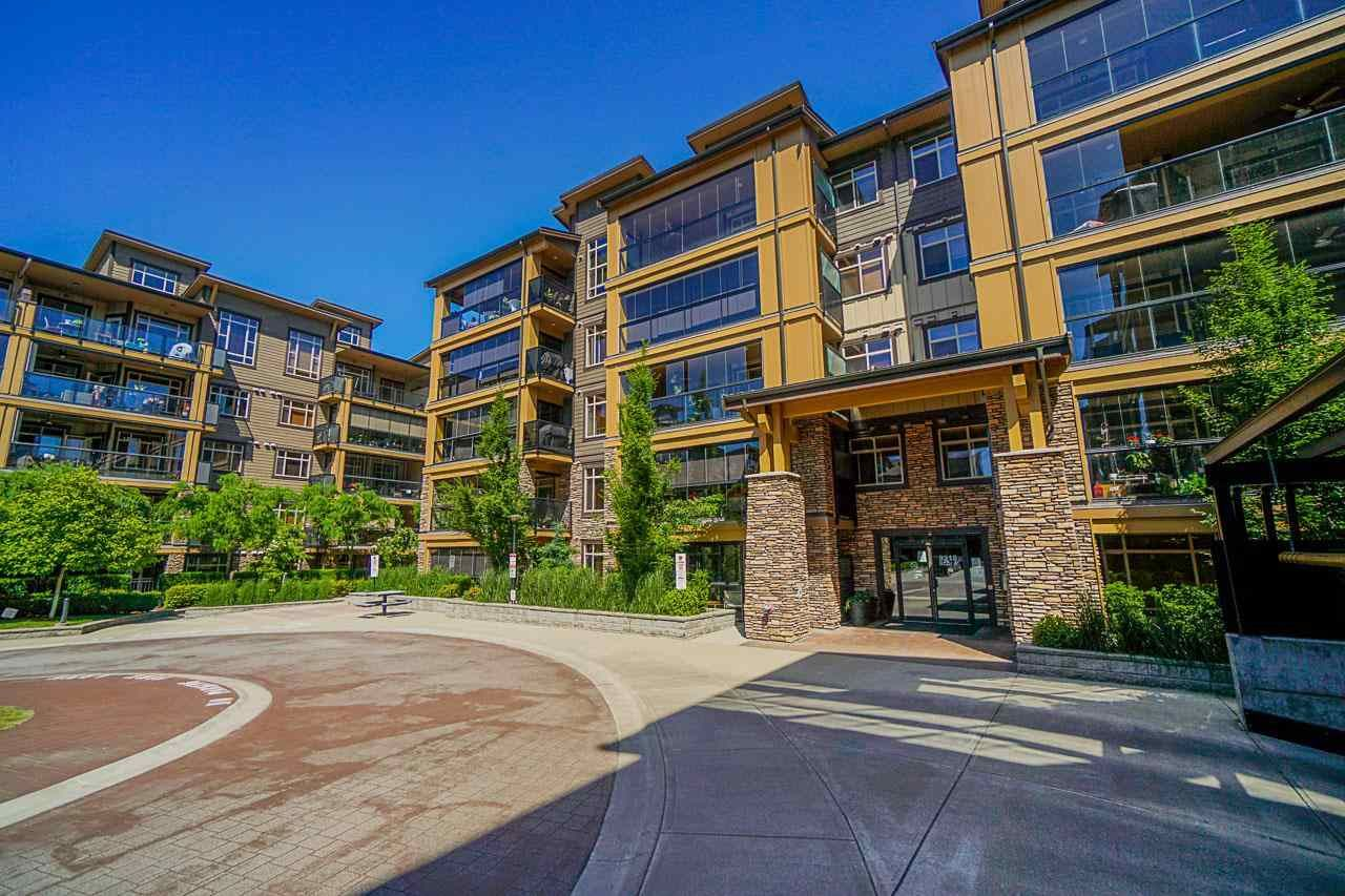"""Main Photo: A408 8218 207A Street in Langley: Willoughby Heights Condo for sale in """"Walnut  Ridge"""" : MLS®# R2588571"""