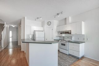 Photo 5: 31 Hamptons Link NW in Calgary: Hamptons Row/Townhouse for sale : MLS®# A1067738