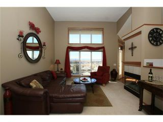 Photo 11: 35 GLENEAGLES View: Cochrane House for sale : MLS®# C4106773