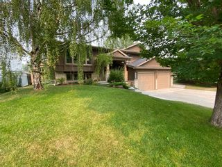 Photo 1: 6742 Leaside Drive SW in Calgary: Lakeview Detached for sale : MLS®# A1137827