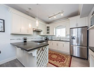 """Photo 3: 208 3488 SEFTON Street in Port Coquitlam: Glenwood PQ Townhouse for sale in """"SEFTON SPRINGS"""" : MLS®# R2165688"""