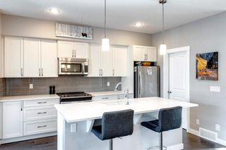 Photo 7: 971 Nolan Hill Boulevard NW in Calgary: Nolan Hill Row/Townhouse for sale : MLS®# A1114155