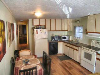 """Photo 2: 49 4200 DEWDNEY TRUNK Road in Coquitlam: Ranch Park Manufactured Home for sale in """"HIDEAWAY PARK"""" : MLS®# V902825"""
