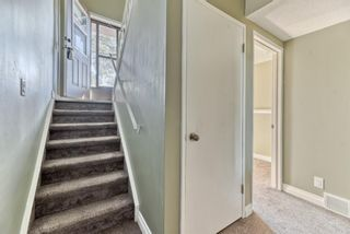 Photo 13: 218 Storybook Terrace NW in Calgary: Ranchlands Row/Townhouse for sale : MLS®# A1126980