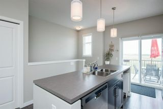 Photo 7: 62 Copperstone Common SE in Calgary: Copperfield Row/Townhouse for sale : MLS®# A1140452