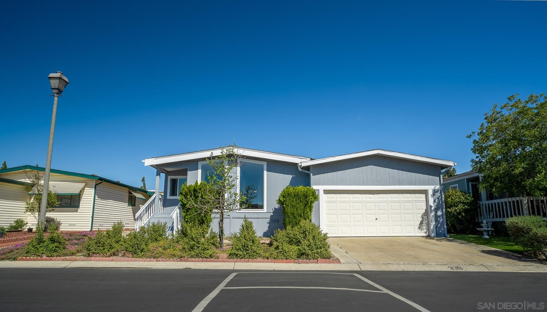 Main Photo: SANTEE Manufactured Home for sale : 3 bedrooms : 9255 N Magnolia Ave #338