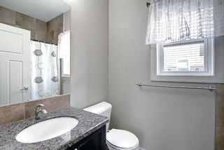 Photo 13: 115 Everhollow Street SW in Calgary: Evergreen Detached for sale : MLS®# A1145858