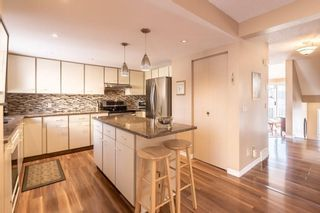 Photo 9: 71 5810 PATINA Drive SW in Calgary: Patterson House for sale : MLS®# C4174307