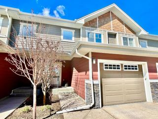 Photo 1: 15 West Coach Manor SW in Calgary: West Springs Row/Townhouse for sale : MLS®# A1100327