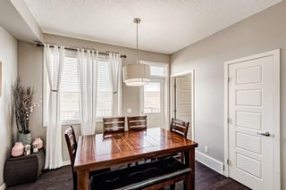 Photo 5: 504 Panatella Walk NW in Calgary: Panorama Hills Row/Townhouse for sale : MLS®# A1153133