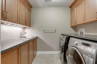 Photo 32: 34 Cougar Ridge Landing SW in Calgary: Cougar Ridge Row/Townhouse for sale : MLS®# A1075174